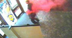 Suspect leaves bank covered in dye
