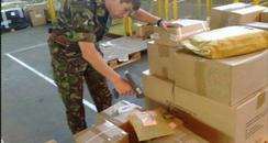 soldiers packing supplies
