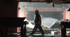 A Fireman inspects what's left of the building.