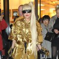 Lady Gaga dressed in  gold outfit