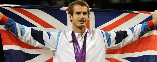 Andy Murray wears his Olympic medals