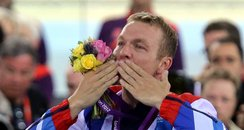 Chris Hoy celebrates winning a gold medal