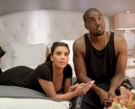 Kanye West and Kim Kardashian on bed