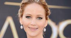 Jennifer Lawrence attends the Oscars 2013 red carpet
