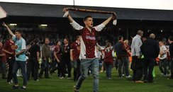 Northampton Town fans invade the Cheltenham pitch