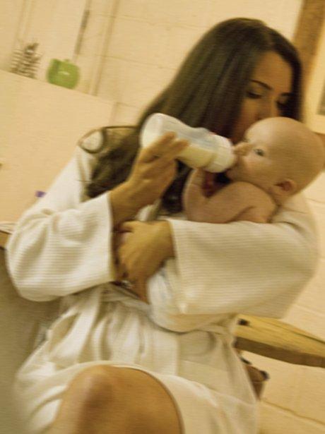 Kate feeds baby George