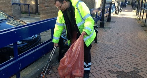 Street Cleaner Picks Up Litter In Wellingborough