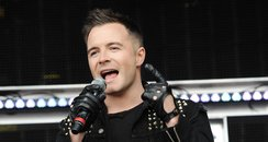 Shane Filan performing on stage