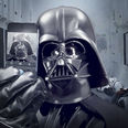Darth Vadar taking a selfie on a smartphone