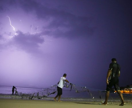Lightning flashing across a purple sky
