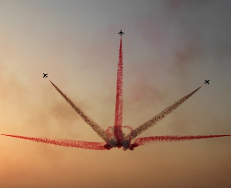 Five planes performing tricks in the sky