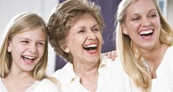 Grandmother, Mother And Daughter Laughing