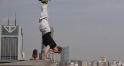 Man Does Handstand At The Top Of A 40 Floor Buildi