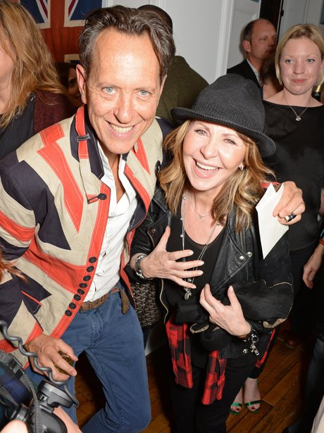Richard E Grant and Lulu hugging