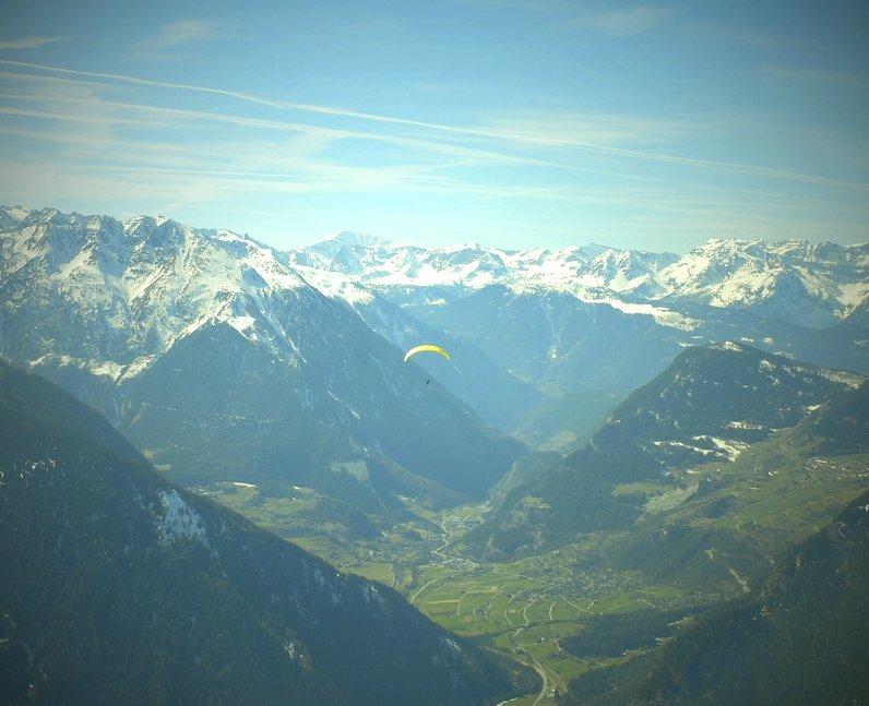A man parachuting in Switzerland
