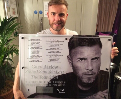Gary Barlow with his tour poster