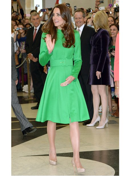 Kate Middleton waving in a green dress