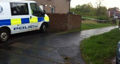 Police van outside victim's home