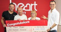 Paul recieving his £100,000 cheque