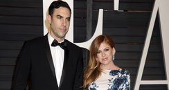 Isla Fisher and Sacha Baron Cohen at the Oscars Va