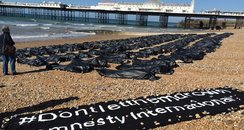 Body bag stunt on Brighton beach