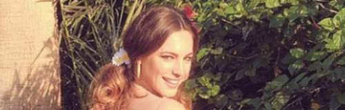 Kelly Brook in a garden