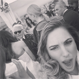Kelly Brook does a photobomb