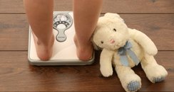 Obese child on scales