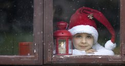 Child looking out of Window Christmas