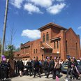 Mourner's walk in to the funeral of Reading mum La