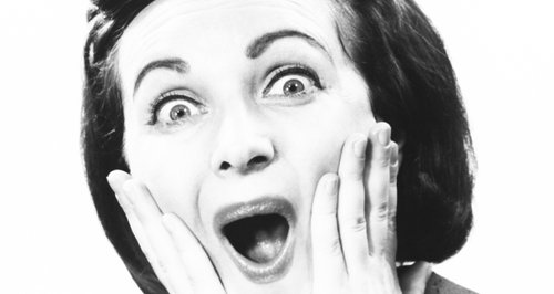 Shocked retro woman black and white