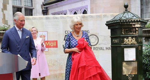 Prince Charles and Camilla unveiling a postbox