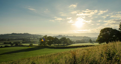 Photograph of sun rising over a Somerset landscape